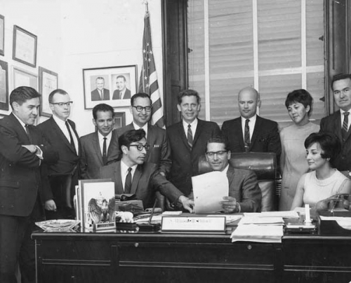 Group portrait of people associated with the Alaska Federation of Natives and others in the office of Howard Pollock in Washington D.C.